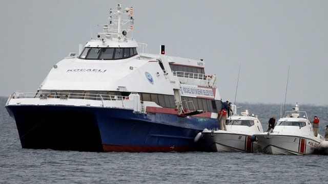 Passengers disembark from the ferry