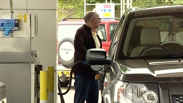 Motorist at petrol station