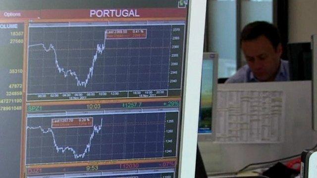 Computer screen showing financial graphs