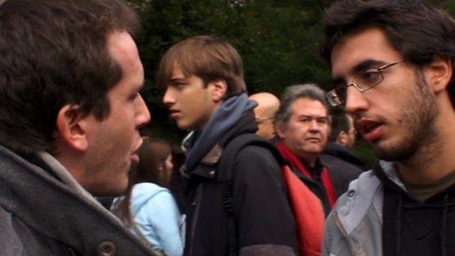 Mark Lowen speaking to protester Oikonomou Giorgos