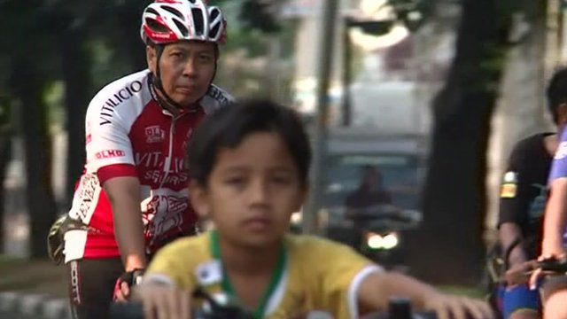 A Sunday bike ride along a main road in Jakarta