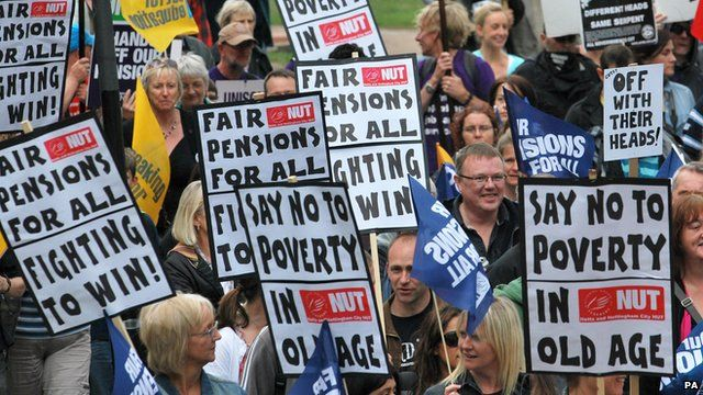 Protesters hold placards in Nottingham city centre during a one day national strike against pension changes in June 2010