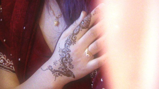 Woman with henna on her hand