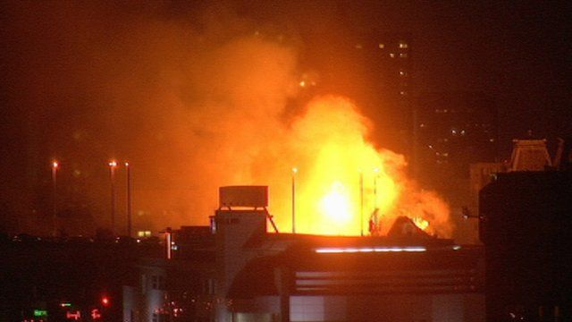 A building burns in Glasgow before firefighters start to bring it under control
