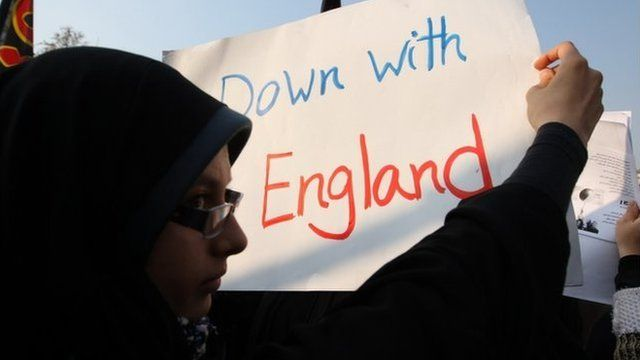 Iranian demonstrators hold 'Down with England' banner