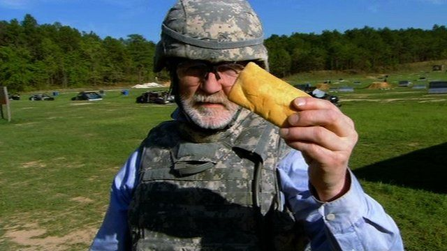 Dr George McGavin holds a sandwich
