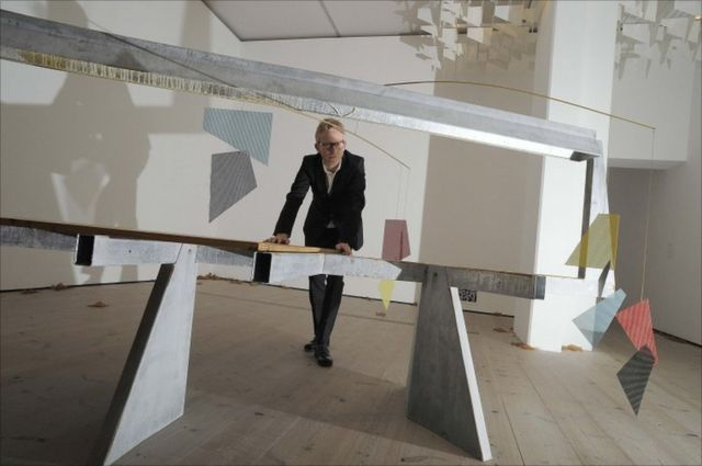 "Martin Boyce poses with his work ""Do Words Have Voices"""