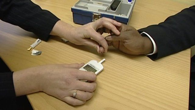 Patient having blood sugar levels checked