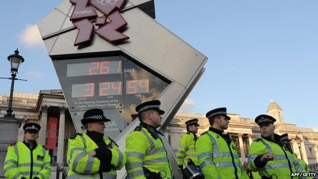 File - Police secure the Olympic countdown clock in Trafalgar Square