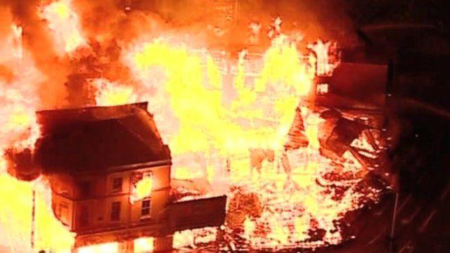 Building burning in riots