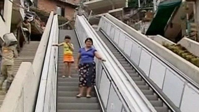 Residents try out the giant outdoor escalator in Medellin