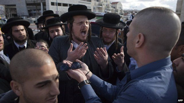 Secular Israelis argue with ultra-Orthodox Jewish protesters in the central town of Beit Shemesh