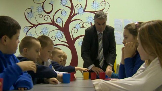 Headteacher and school children