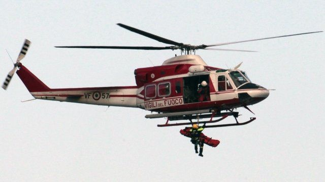 Crew member is winched into helicopter
