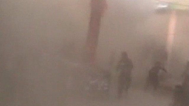 Dust fills the street the moment immediately after the explosion