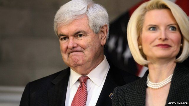 Republican presidential candidate and former Speaker of the House Newt Gingrich stands with his wife, Callista