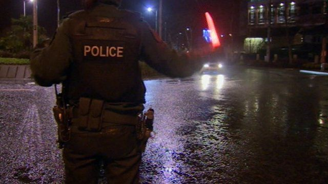 Police officer directs traffic in Derry