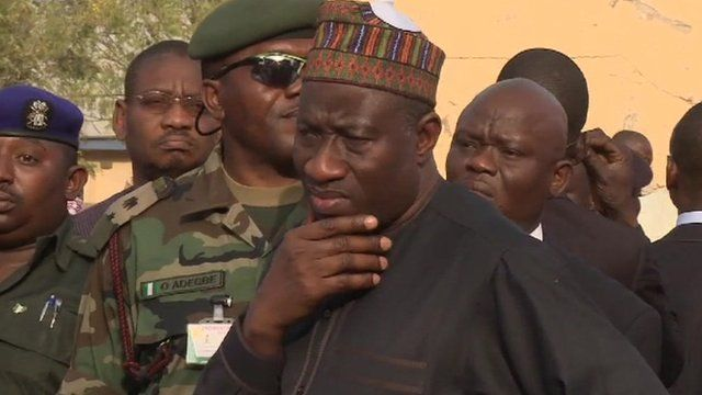 Nigerian president Goodluck Jonathan surveys blast damage.