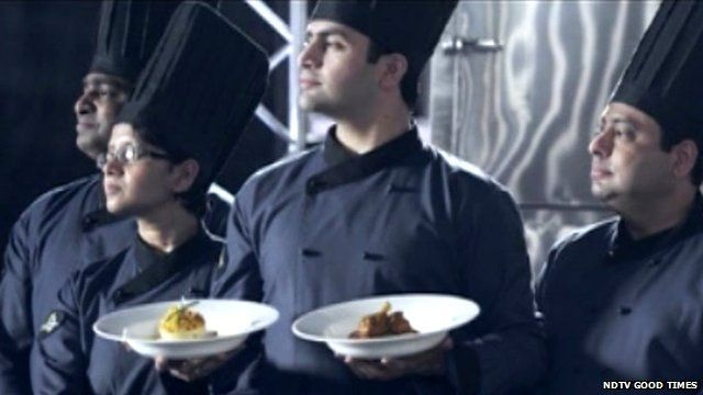 Chefs with food in trailer for Foodistan
