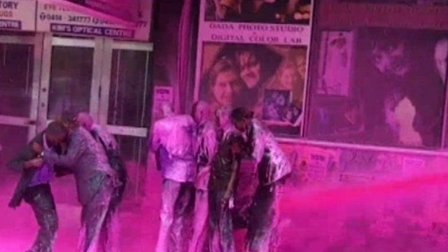 Security forces use coloured water spray against Ugandans