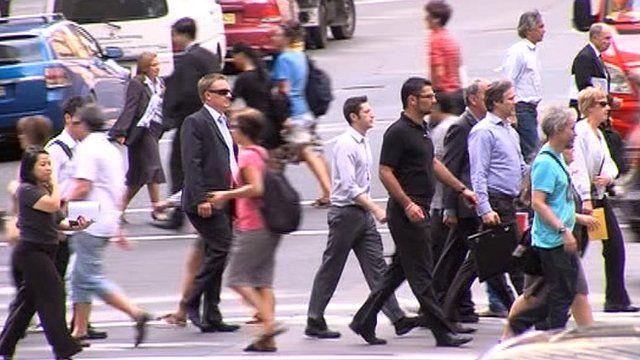 Commuters in Sydney crossing road