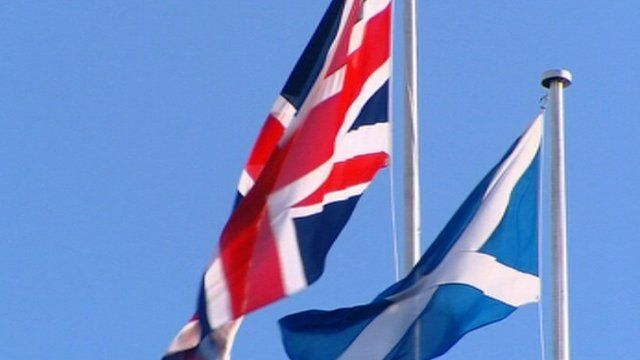 Union Flag and Saltire blowing in the wind