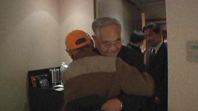 Two brothers share a hug