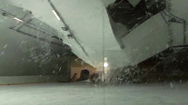 Roof caves in under weight of snow