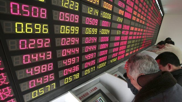 Investors check stock prices in Shanghai