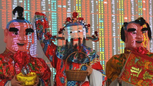 Men dressed as gods of fortune on the opening day of the Taiwan Stock Exchange