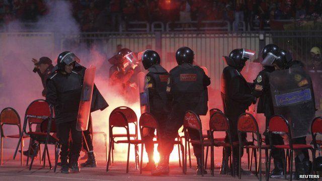 Riot police inside the stadium