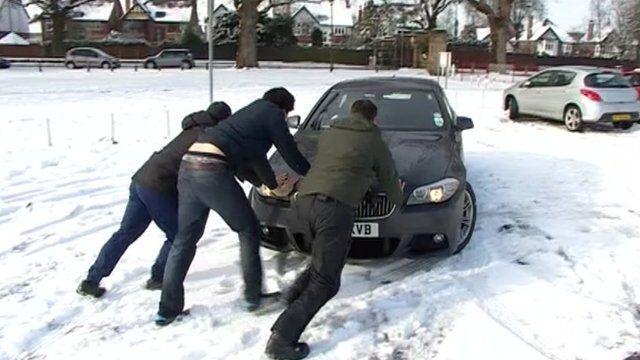 Men pushing car