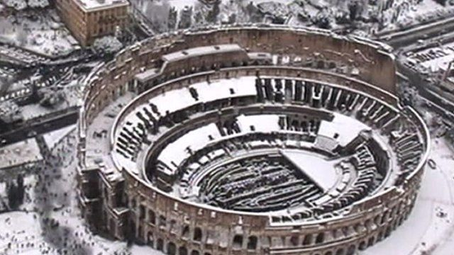 A snow covered colosseum in Rome