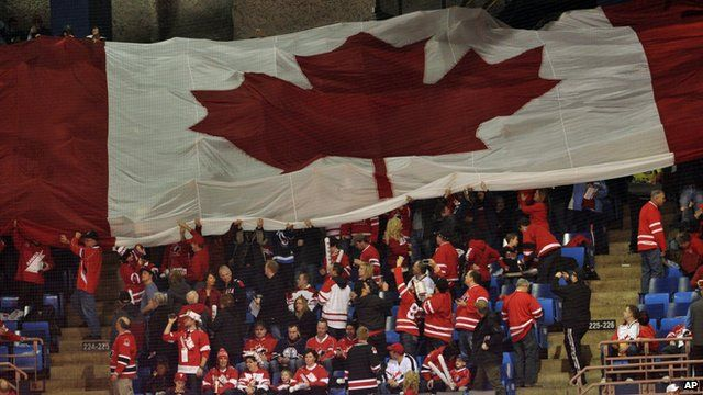 Canada flag and Canadian hockey fans