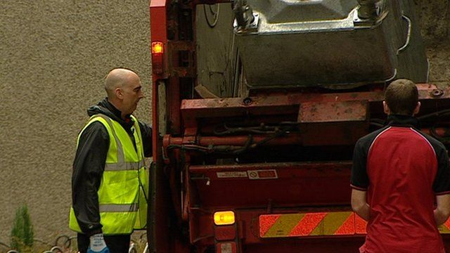 A bin is emptied into a rubbish lorry