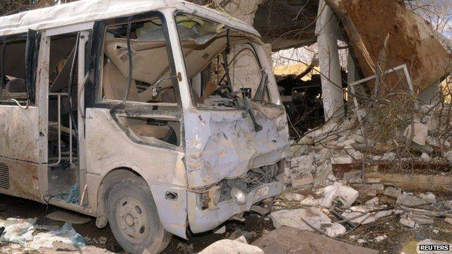 Bomb-hit bus in Aleppo