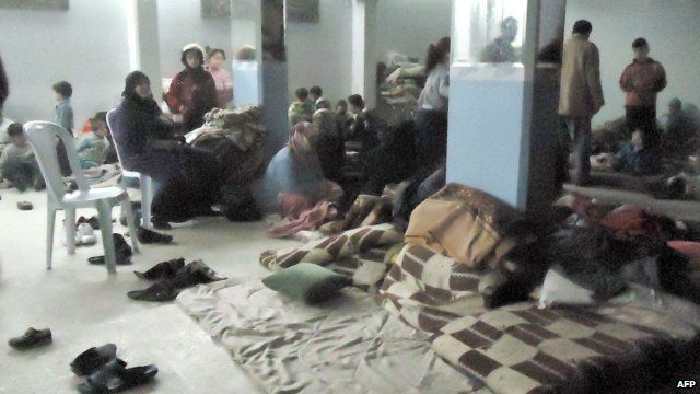 Syrian families hiding in a shelter in Homs
