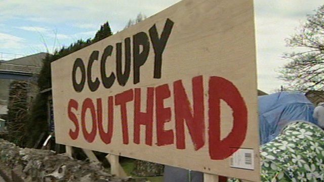 Occupy Southend sign and tents in the churchyard