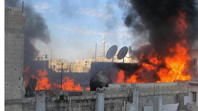 Fire on roof of building in Baba Amr