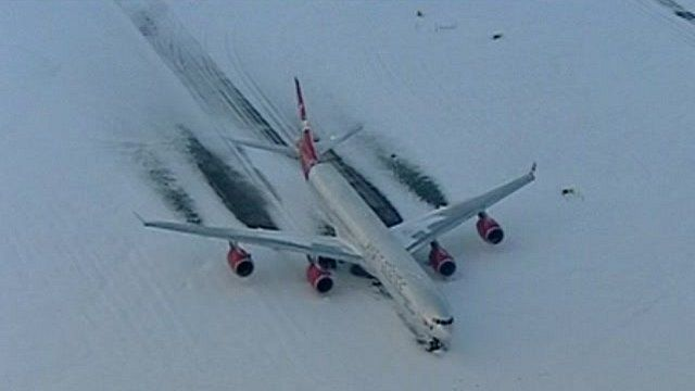 Plane on snow-covered runway