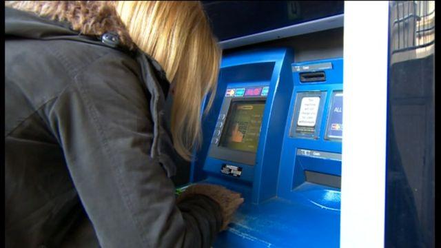 Suzie Simons using cash machine