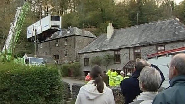 Lorry being winched out of narrow road in Cornwall