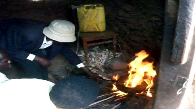 "People using the ""Jompy Boiler"" over a fire"