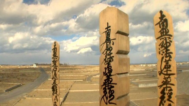 Empty plains that were once Japan's Yuriage - with wooden stakes in the foreground.