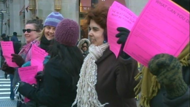 Protesters waving pink leaflets