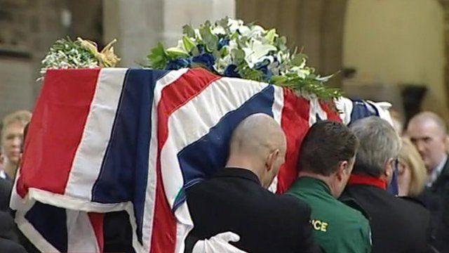 Pall bearers carry PC David Rathband's coffin