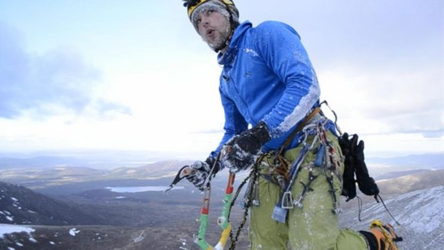 Climber Gregg Boswell on top a Scottish Hill