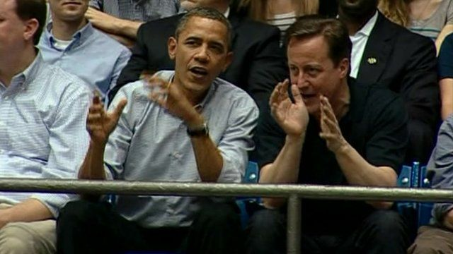 Barak Obama and David Cameron watch basketball game in Ohio.