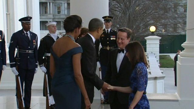 President Obama shakes hands with Samantha Cameron as David Cameron and Michelle Obama look on