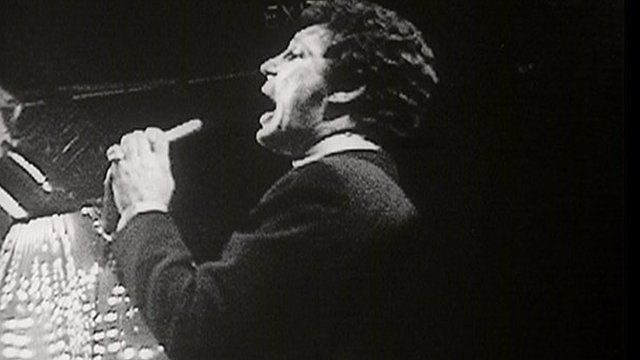 Tom Jones performing in 1968 on Top of the Pops, in black and white.